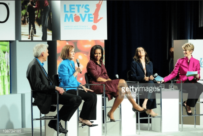 Elizabeth Ward, MS, RD on stage with Michelle Obama during a forum on childhood wellness.