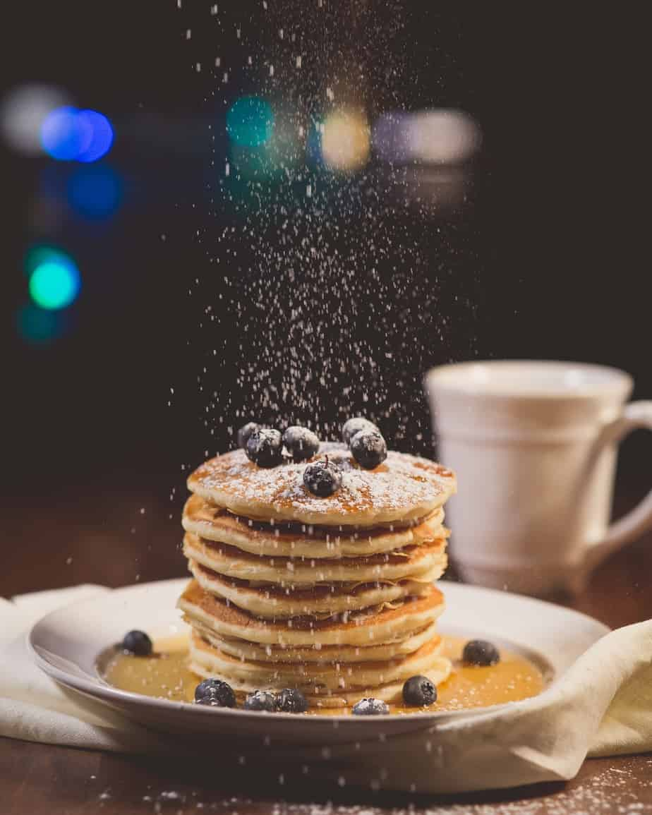 Kids love breakfast for dinner like these pancakes with blueberries.