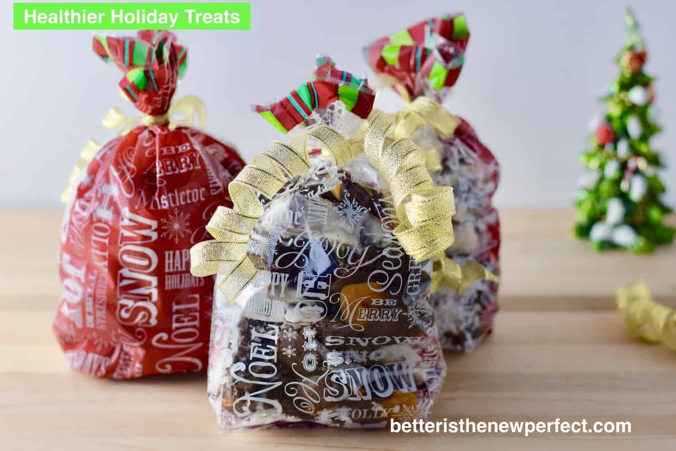 bags of holiday candy wrapped with ribbon