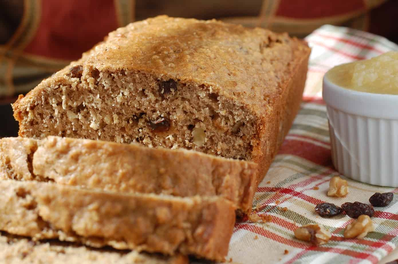 Loaf of healthy walnut raisin quick bread.