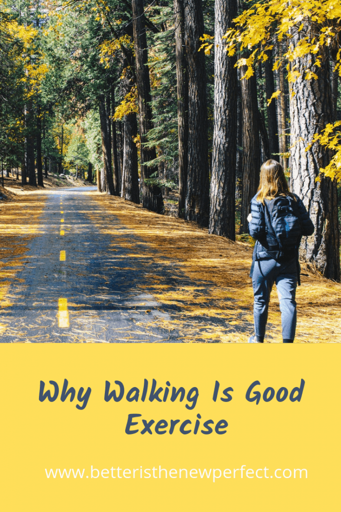 woman with backpack walking on a road in fall pinterest graphic