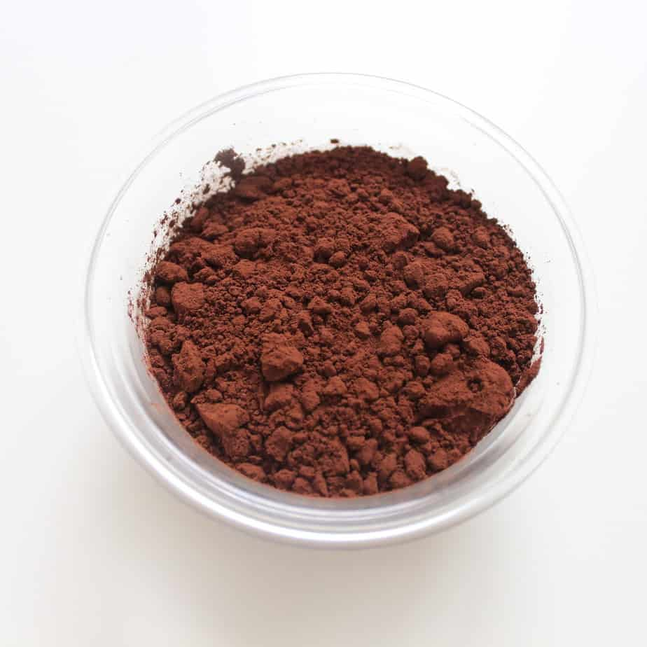 Bowl of unsweetened cocoa powder.