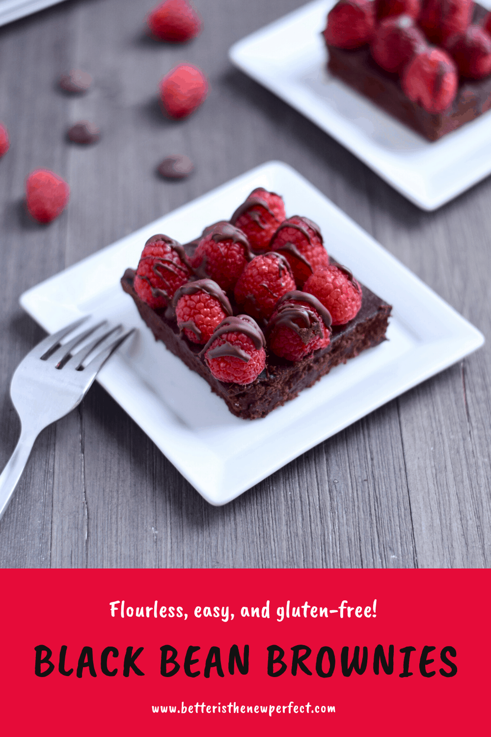 Two black bean brownies topped with fresh raspberries on white plates on a gray background.