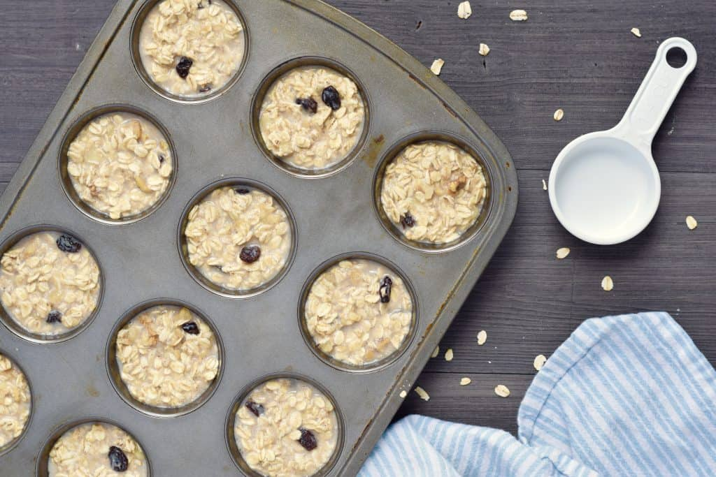 no added sugar banana raisin oatmeal cup batter in muffin pan