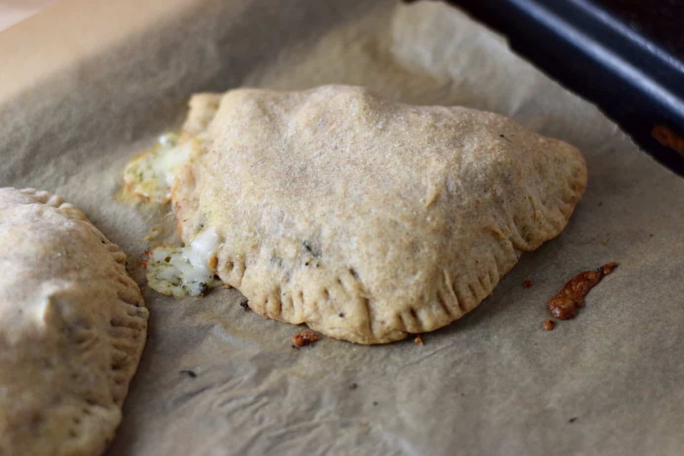 Golden brown savory vegetarian hand pies with broccoli and cheese