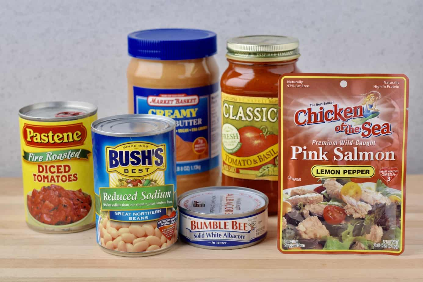 canned tomatoes, beans, tuna fish, peanut butter, tomato sauce, pouched salmon