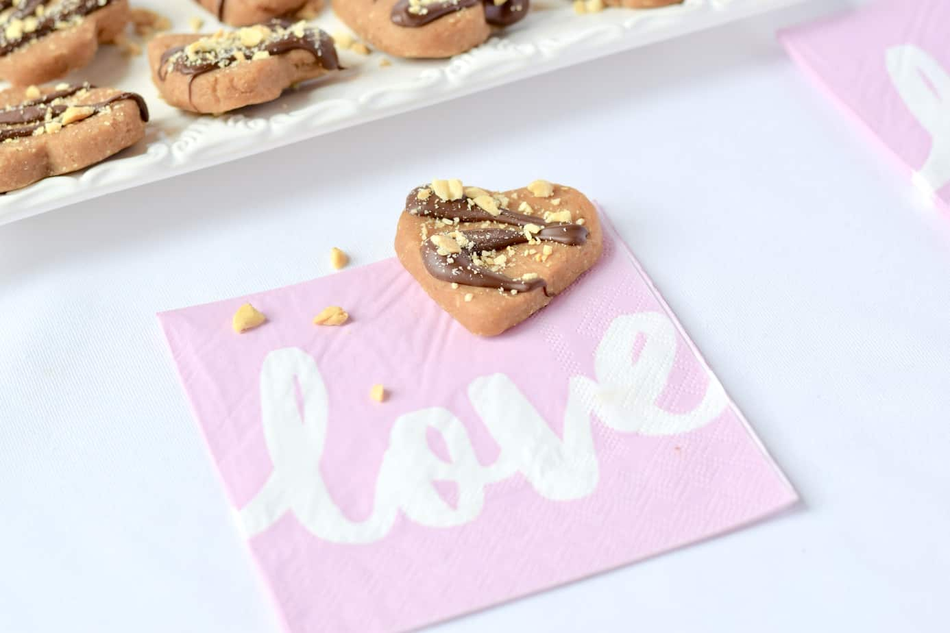 Vegan peanut butter and peanut heart-shaped dessert on Love napkin.