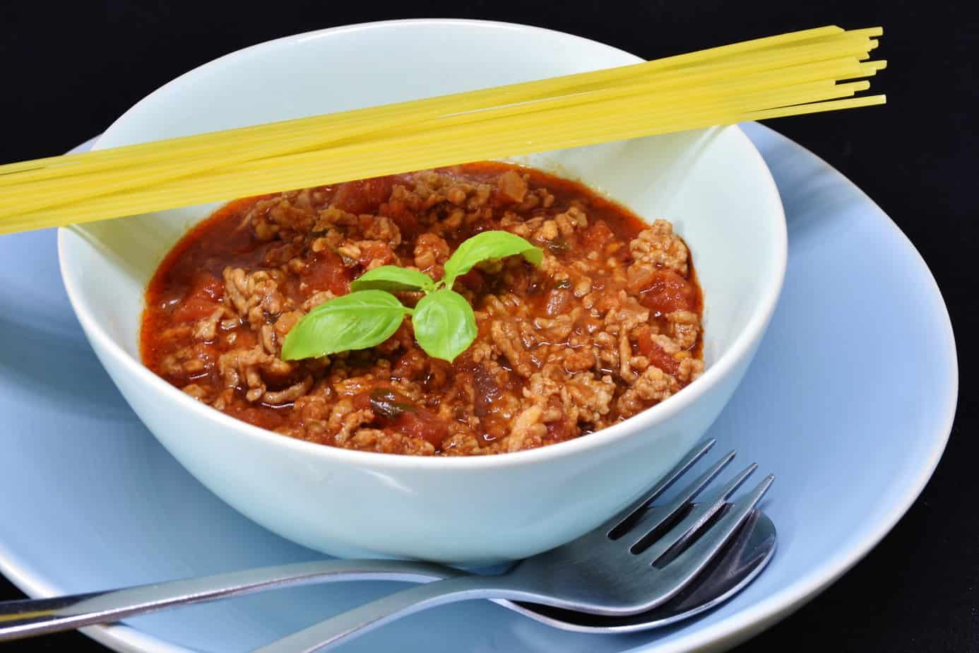 Shows a bowl of chili to show that nourishing meals can be simple.