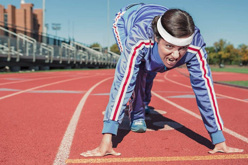 image of a woman in track suit ready to run a race.