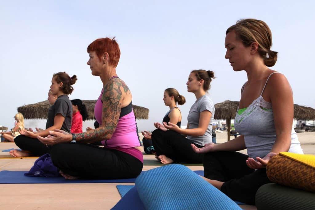 women doing yoga outside