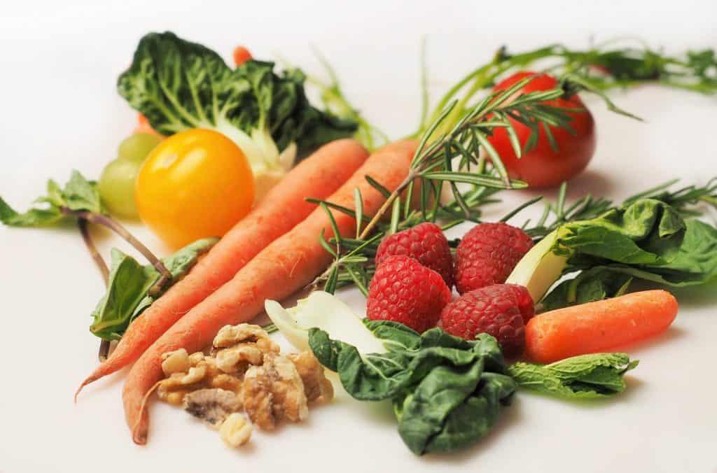 Fresh carrots, fresh strawberries, fresh tomatoes, fresh greens