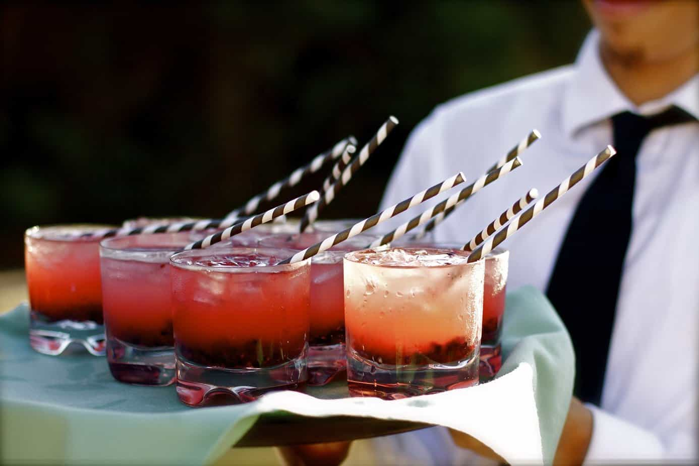 tray of cocktails with striped straws