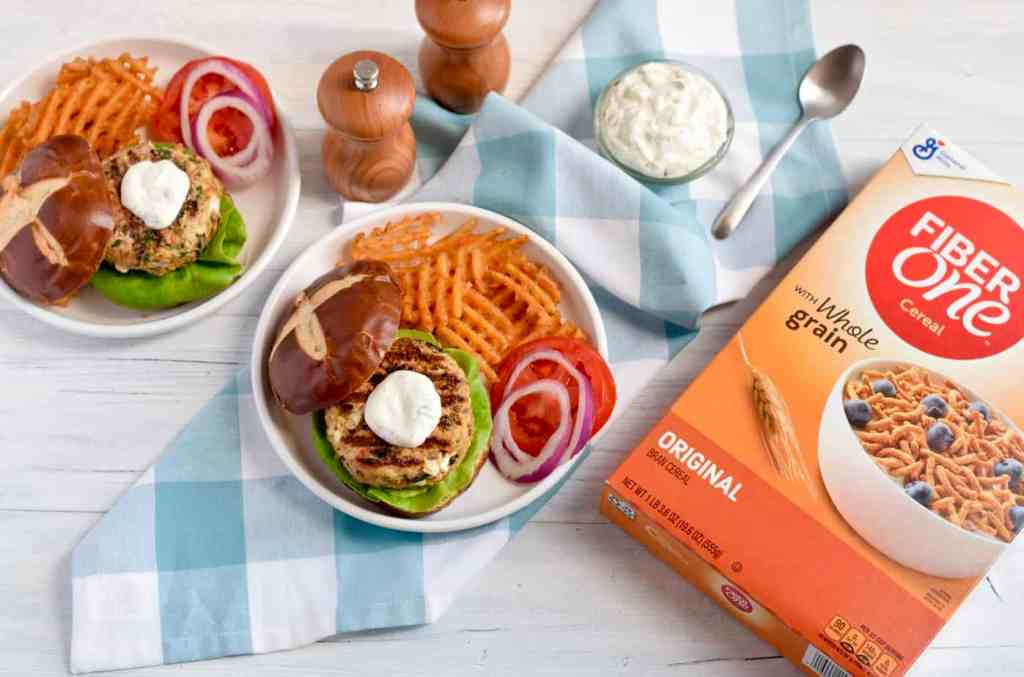 burgers on plate with Fiber One Cereal box