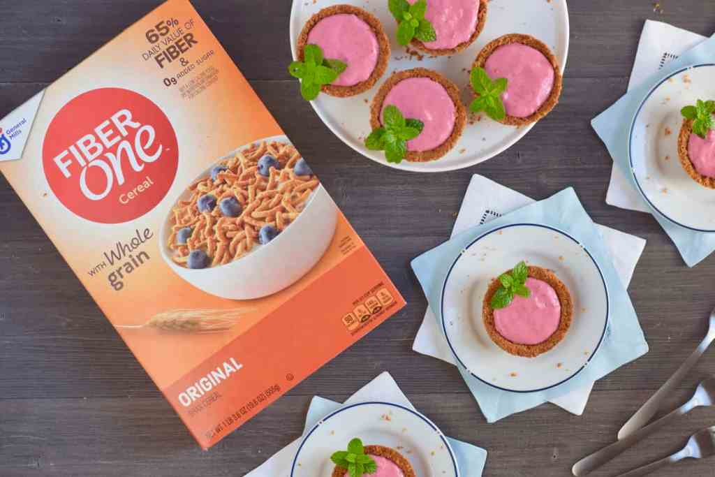 Fiber One cereal box with dessert cups filled with raspberry yogurt